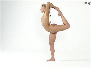 towheaded teenage flexy girl demonstrates her talents