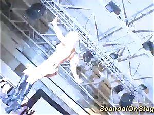 ash-blonde buxomy babe sploog on public stage