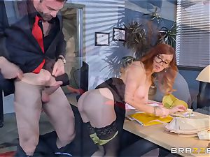 Dani Jensen toying with salami in the office
