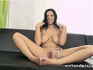 busty Elena Rae pisses through her tights