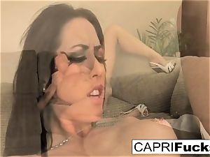Capri likes to use various fucktoys on her moist tight beaver
